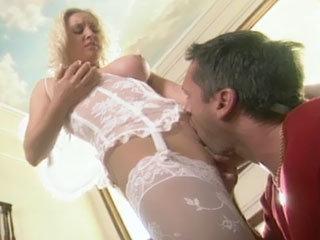 Calli Cox is a blonde vixen with a perfect pair of natural big tits that you will be seeing a lot in this scene. She comes in wearing her stockings and corset, then joins our stunt cock in the living